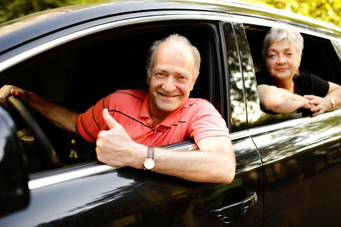 Happy Senior Couple travelling in their car